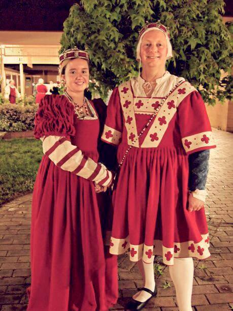 Aonghus mac Griogair mhic Raghnaill and Ginevra Lucia di Namoraza, fifth Baron and Baroness of Politarchopolis. This is a photo of them at their investiture, courtesy of Ginevra.