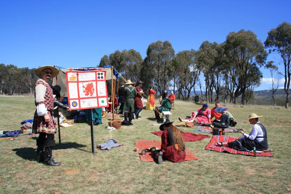 picnicking crowd and the banner on display
